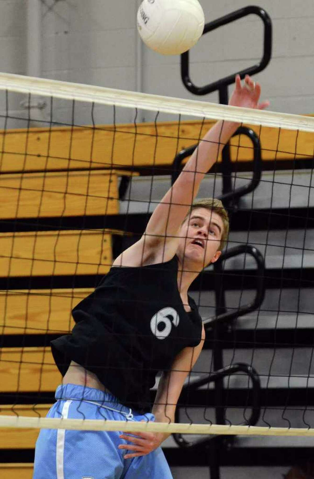 Darien's Calder Billhardt makes a kill against Staples during the boys volleyball FCIAC championship match at Fairfield Ludlowe on Friday, May 27, 2011.