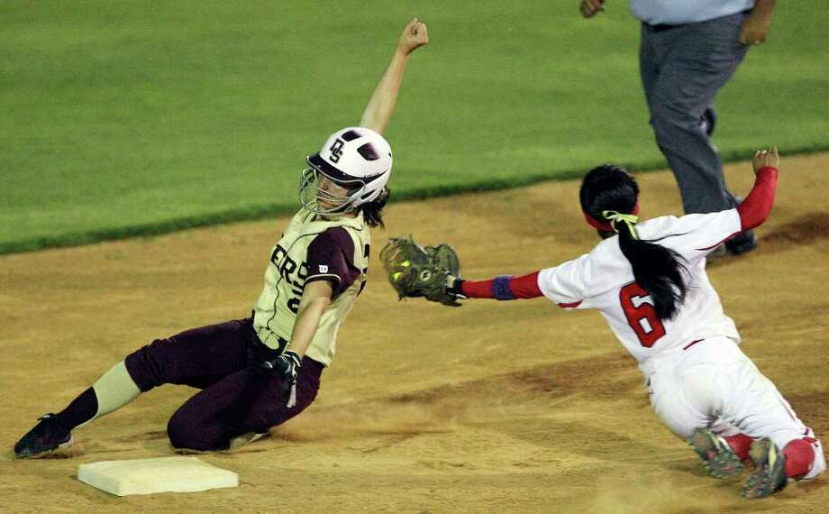 Dripping Springs' Aspen Herron steals second base around New Braunfels Canyon's Brittany Gomez  during the fourth inning in the Class 4A regional final held Friday, May 27, 2011, at SAISD Sports Complex. Photo: Edward A. Ornelas/Express-News / eaornelas@express-news.net
