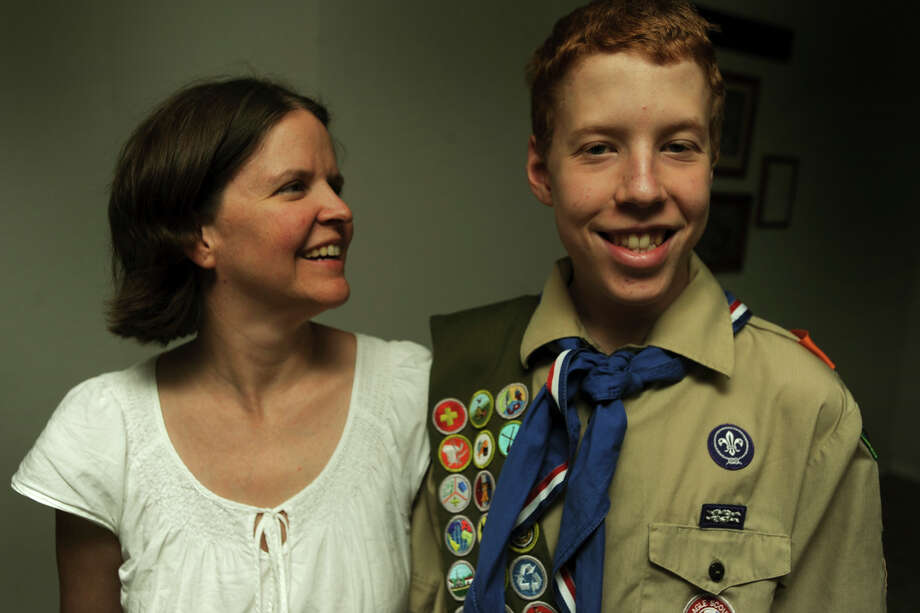 Rana Burr says she's thrilled for son Montana, 15, who was diagnosed with autism when he was 6 but did not let that stop him from becoming an Eagle Scout. Photo: BILLY CALZADA/gcalzada@express-news.net