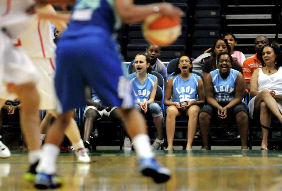 Members of the Lady Dreams AAU basketball team for 12-year-olds cheer for the New York Liberty WNBA team as they play Chinese National on Friday, May 27, 2011, at Times Union Center in Albany, N.Y. (Cindy Schultz / Times Union) Photo: Cindy Schultz