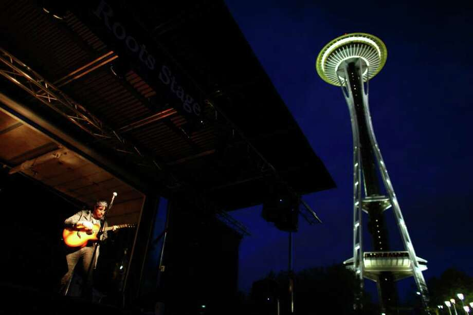 Chris Cunningham of local band Ravenna Woods performs at the Indie Roots Stage during the 40th annual Northwest Folklife Festival. Photo: JOSHUA TRUJILLO / SEATTLEPI.COM