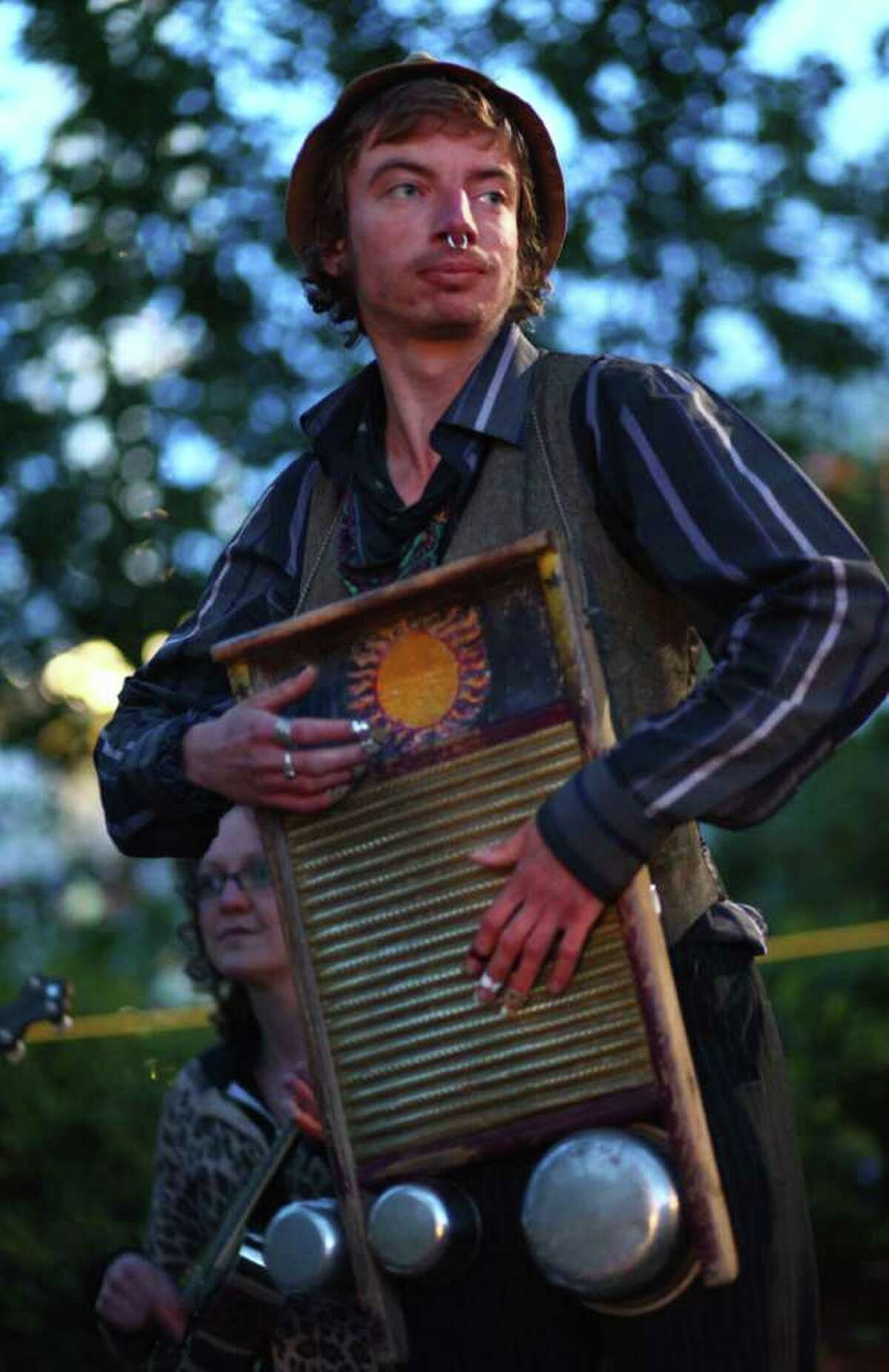 Po, of the band Same Old Use To Be's, plays a washboard and cans during the 40th annual Northwest Folklife Festival. Members of his band have been regular buskers at the festival for many years.