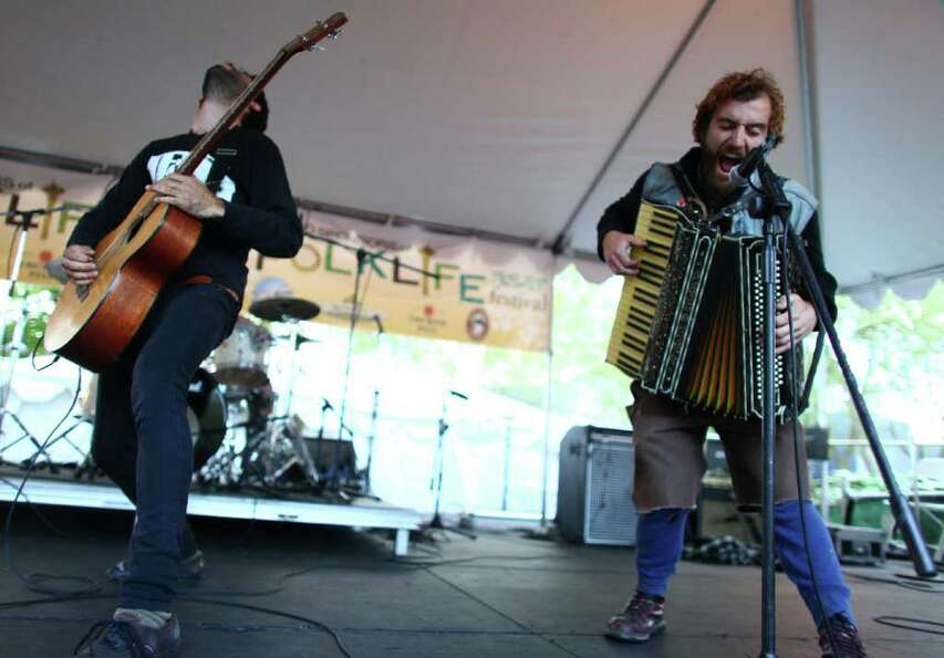 The band Di Nigunim performs folk punk music on the Fountain Lawn Stage.