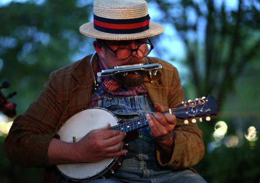 Jazzbo Hamhock plays the banjo and harmonica with his band, the Same Old Use To Be's.