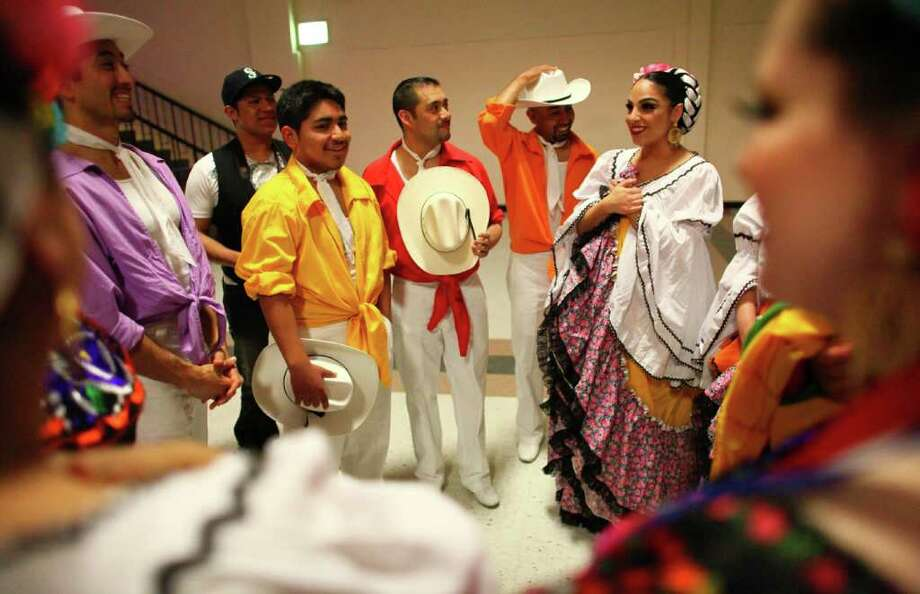 Dancers with Bailadores de Bronce prepare to go onstage. Photo: JOSHUA TRUJILLO / SEATTLEPI.COM