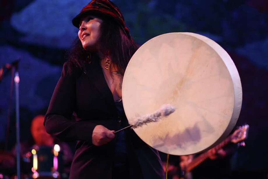 Star Nayea with Native American funk soul band A Little Big Band plays a drum during a performance at the Mural Amphitheater. Photo: JOSHUA TRUJILLO / SEATTLEPI.COM