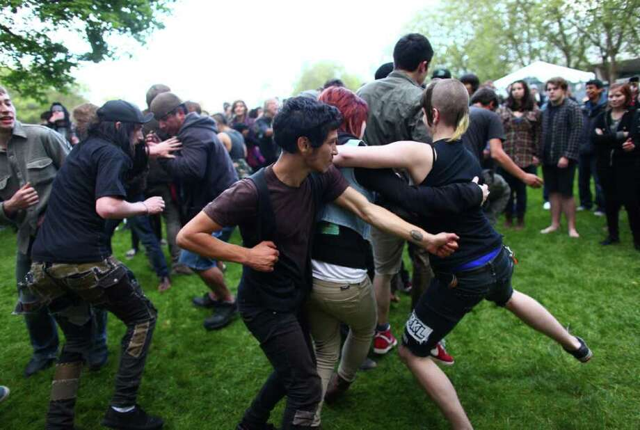 Fans mosh to music from the punk folk band Di Nigunim. Photo: JOSHUA TRUJILLO / SEATTLEPI.COM