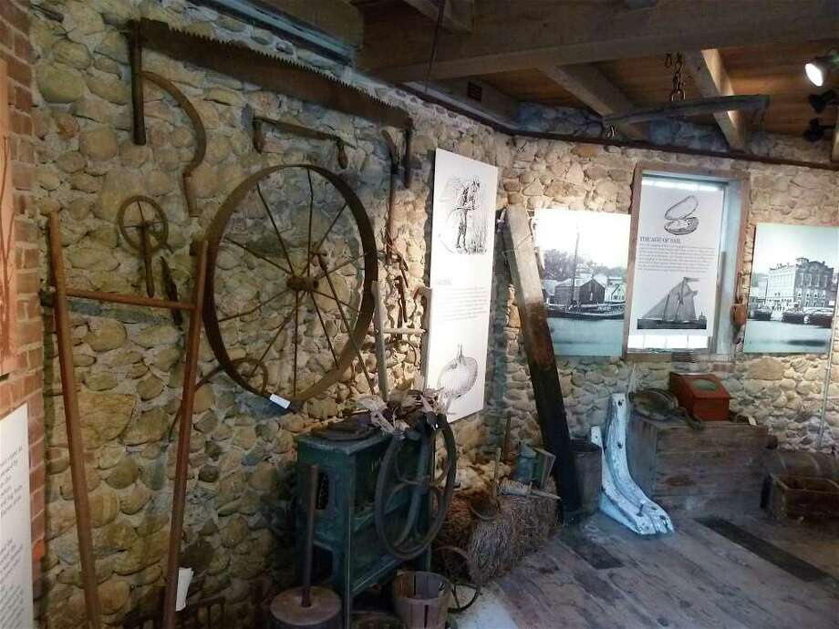 """Vintage farm tools on display in the Bradley-Wheeler Cobblestone Barn that adjoins the Westport Historical Society headquarters, part of the exhibit """"Back to Our Roots."""" Photo: Contributed Photo/Mike Lauterborn, Contributed Photo / Westport News contributed"""