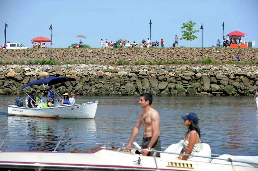 Boaters and families along the shore enjoy the Stamford Harbor Live event in Stamford, Conn. on Saturday May 28, 2011.