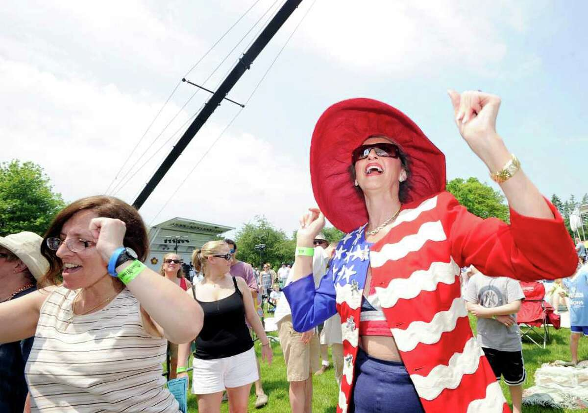 Cindy Castronovo-Morabito, right, dances to the music of Toots and the Maytals during the Greenwich Town Party in Roger Sherman Baldwin Park, Saturday afternoon, May 28, 2011.