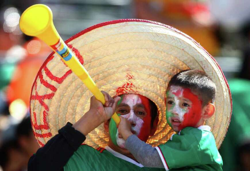 A fan makes noise with a vuvuzela during a friendly match between Mexico and Ecuador on Saturday, Ma