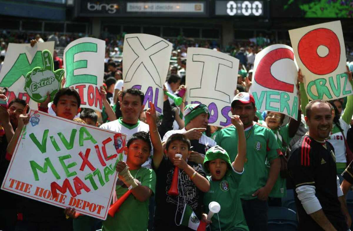 Mexico supporters, which far outnumbered Ecuador fans, cheer for thier team during a friendly match between the two international teams at Qwest Field in Seattle.