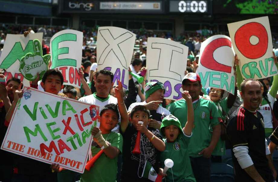 Mexico supporters, which far outnumbered Ecuador fans, cheer for thier team during a friendly match between the two international teams at Qwest Field in Seattle. Photo: JOSHUA TRUJILLO / SEATTLEPI.COM