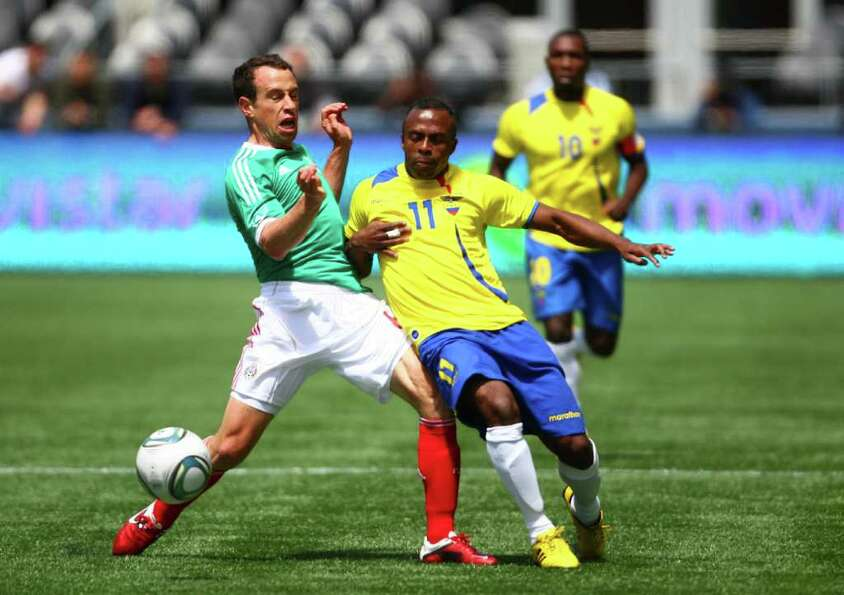 Mexico player Gerardo Torrado, left, tries to take the ball from Ecuador player Cristian Benitez. Th