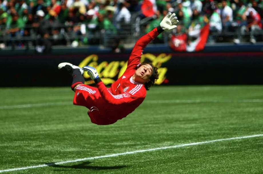 The ball gets past Mexico keeper Guillermo Ochoa, allowing Ecuador a goal. Photo: JOSHUA TRUJILLO / SEATTLEPI.COM