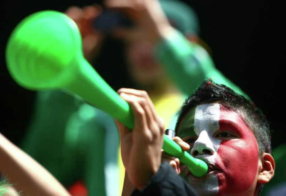 A fan makes noise with a vuvuzela during a friendly match between Mexico and Ecuador on Saturday, May 28, 2011 at Qwest Field in Seattle. Photo: JOSHUA TRUJILLO / SEATTLEPI.COM