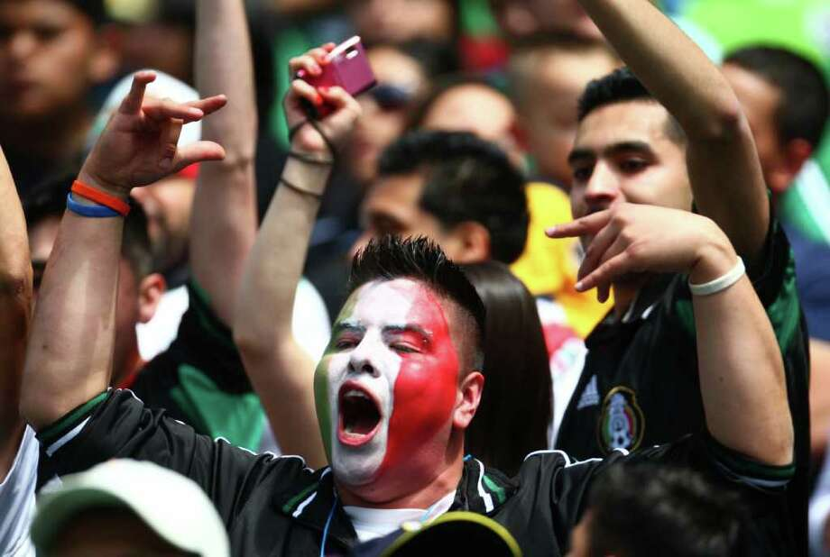 A fan of Mexico cheers during a friendly match against Ecuador. Photo: JOSHUA TRUJILLO / SEATTLEPI.COM