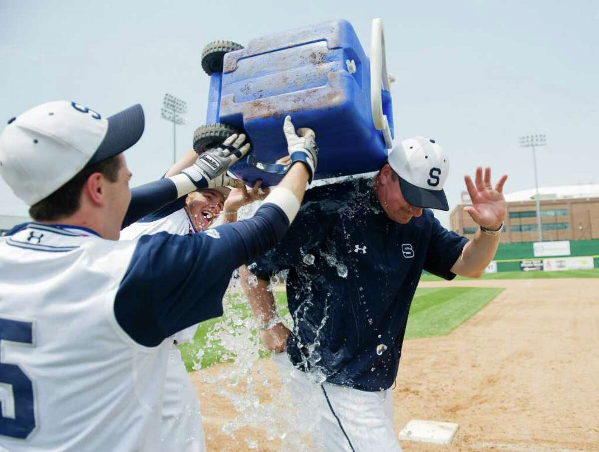 Staples High School head coach Jack McFarland is drenched after defeating Danbury High School 5-3 in FCIAC baseball championship at Harbor Yard in Bridgeport, Conn. on Saturday May 28, 2011.