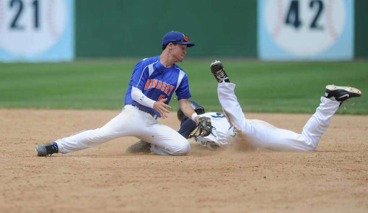 Staples High School's Bryan Terzian slides safely into second as Danbury High School's Robbie Meerman tries to make the tag in the FCIAC baseball championship at Harbor Yard in Bridgeport, Conn. on Saturday May 28, 2011. Staples won the game 5-3.