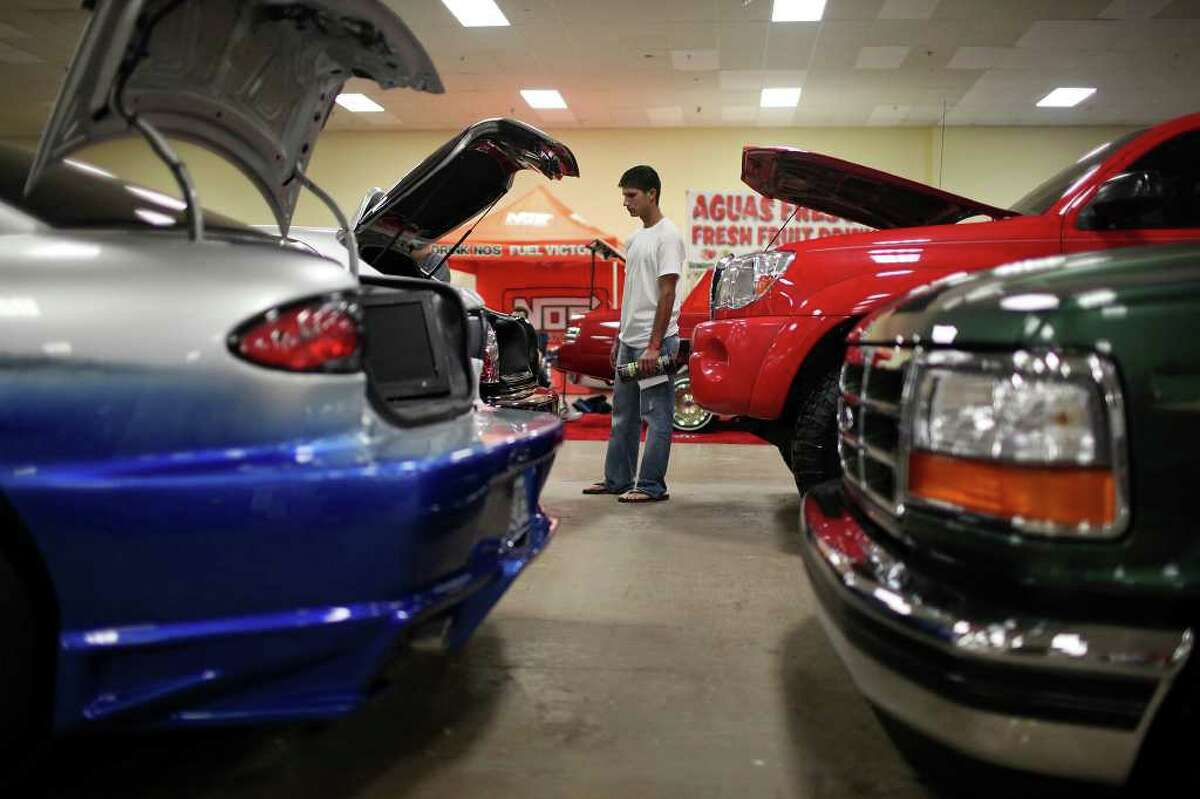 Paul Escobedo, 19, from Del Rio, takes in the sights during the 2011 Heat Wave Auto Fest held Saturday, May 28, 2011, at the San Antonio Event Center. The event, which runs through Sunday, May 29, 2011, included live entertainment, food and drinks and a tattoo expo.