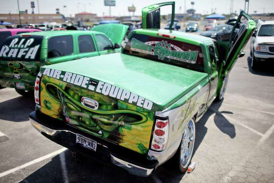 "Jerry ""Bubba"" Castilleja's 2002 GMC Sierra sits on display during the 2011 Heat Wave Auto Fest held Saturday, May 28, 2011, at the San Antonio Event Center. The event, which runs through Sunday, May 29, 2011, included live entertainment, food and drinks and a tattoo expo. Photo: Edward A. Ornelas/Express-News"