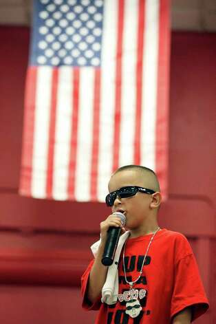 "Jullian ""Dezi"" Blanco, 7, from Corpus Christi, performs during the 2011 Heat Wave Auto Fest held Saturday, May 28, 2011, at the San Antonio Event Center. The event, which runs through Sunday, May 29, 2011, included live entertainment, food and drinks and a tattoo expo. Photo: Edward A. Ornelas/Express-News"
