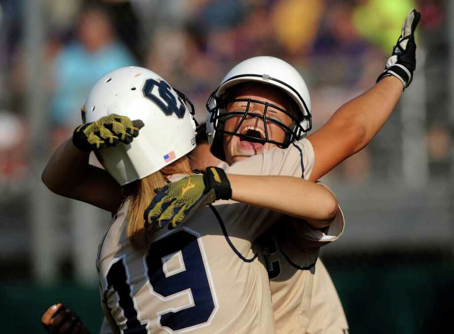 O'Connor's Taylor Vidrine (19) is embraced by teammate Brittany Stone after Vidrine hit a home run against San Benito during the 5A Regional Softball Finals in Corpus Christi on Saturday, May 28, 2011. Photo: Billy Calzada/Express-News / gcalzada@express-news.net