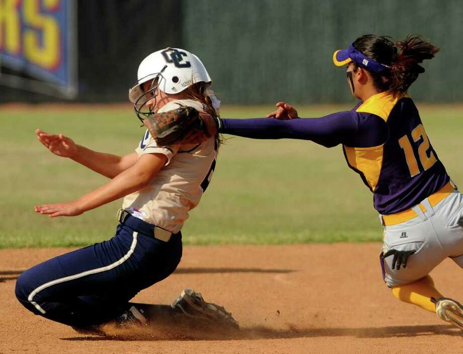 San Benito second baseman Amanda Garza (12) tags out O'Connor's Hannah Fields during the 5A Regional Softball Finals in Corpus Christi on Saturday, May 28, 2011. Photo: Billy Calzada/Express-News / gcalzada@express-news.net