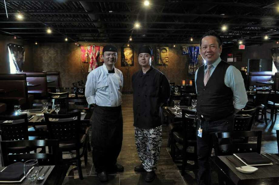 Wilfred Sheng, left, and Andy Lin, center, co-owners of Duo, stand in the restaurant's dining room, with Eddie Chan, general manager, right, on Tuesday May 24, 2011 in Saratoga Springs, NY.  ( Philip Kamrass / Times Union) Photo: Philip Kamrass