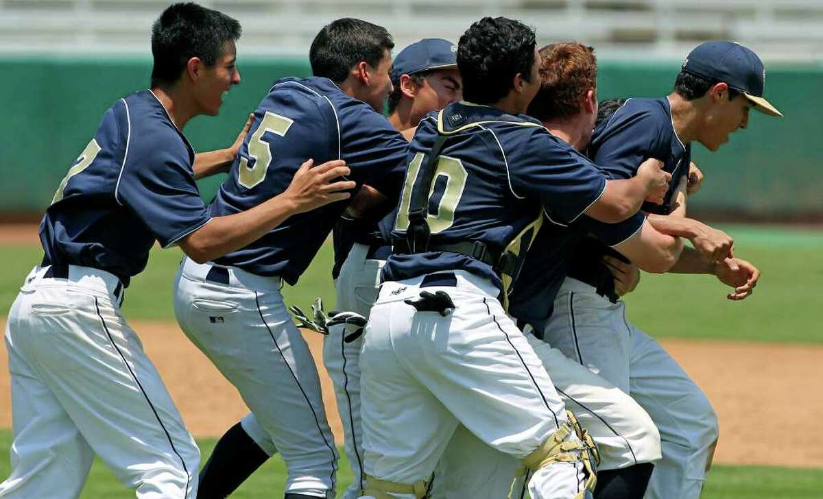 Laredo Alexander players swarm the winning pitcher as Churchill loses 5-4 to Alexander at Wolff Stadium on Saturday, May 28, 2011.