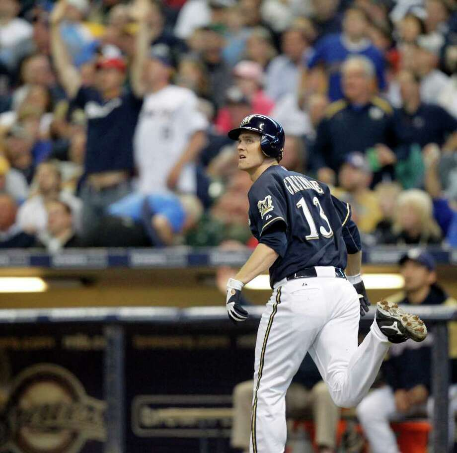 Brewers pitcher Zack Greinke watches his home run, off the Nationals' Jason Marquis, leave Miller Park on Wednesday. Photo: Jeffrey Phelps/Associated Press