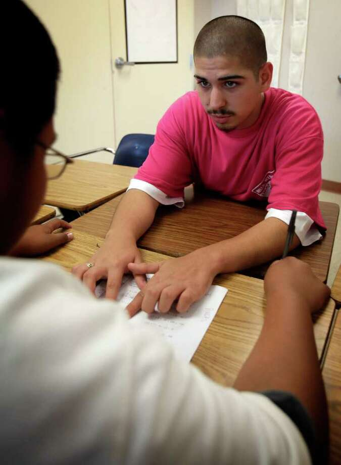 Jose Franco, an eighth grader at Twain Middle School, helps tutor seventh grade math students that are having trouble with the subject.  He is participating in the Middle School Partners Program and will be attending SAISD's Travis Early College High School in the fall.  Wednesday, May 25, 2011.  Photo Bob Owen/rowen@express-news.net Photo: BOB OWEN, Bob Owen/Express-News / rowen@express-news.net