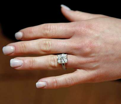 Candice Crawford, a former local sports reporter, shows friends her engagement ring that Dallas Cowboys quarterback Tony Romo gave her, while she participates in the 2011 Spring Luncheon benefiting Nexus Recovery Center, Thursday, May 12, 2011, in Dallas. Photo: AP