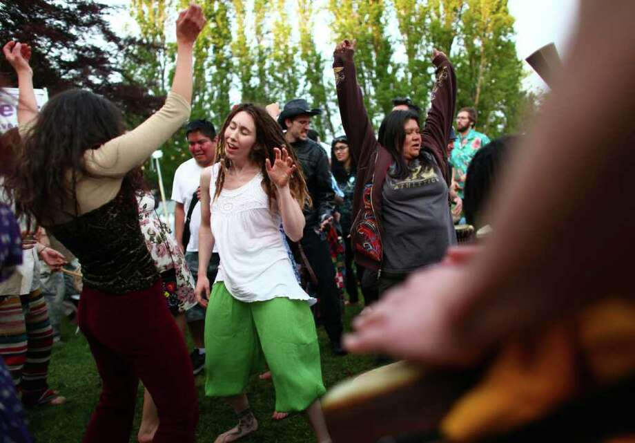 People dance during a drum circle at the Northwest Folklife Festival. Photo: JOSHUA TRUJILLO / SEATTLEPI.COM