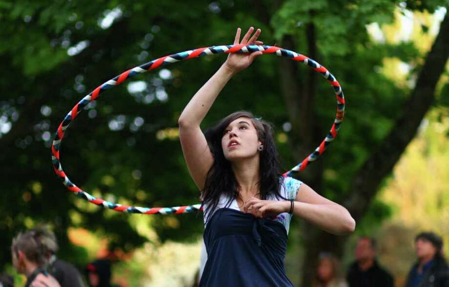 Elly Taylor of Seattle twirls a Hula Hoop during the Northwest Folklife Festival. Photo: JOSHUA TRUJILLO / SEATTLEPI.COM