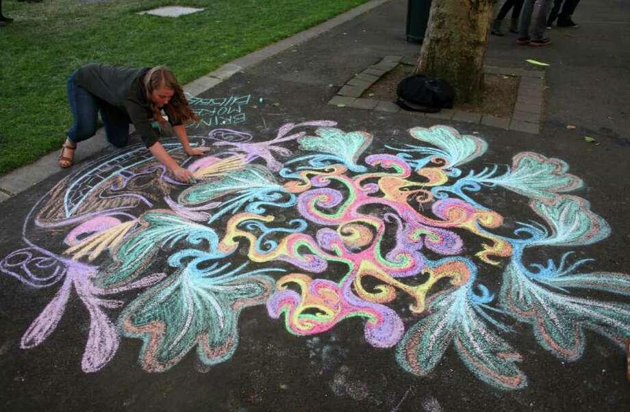 Laurel Fisher of Gig Harbor creates chalk art. Photo: JOSHUA TRUJILLO / SEATTLEPI.COM