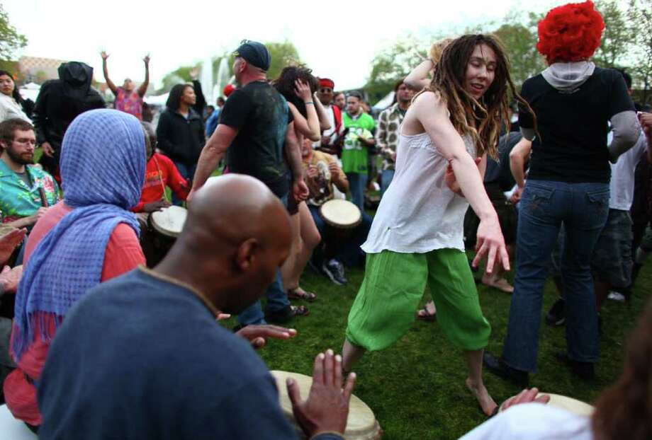 Tiffany Ann Bersano, right, dances in a drum circle during the Northwest Folklife Festival. Photo: JOSHUA TRUJILLO / SEATTLEPI.COM
