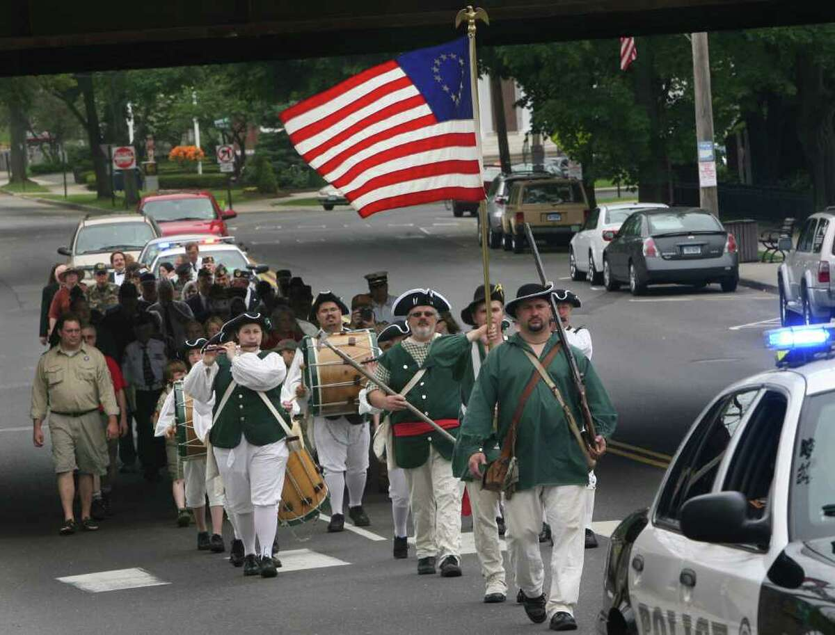 Milford Volunteers Ancient Fife and Drum Corps march during the Milford wreath laying ceremony on Sunday, May 29, 2011.