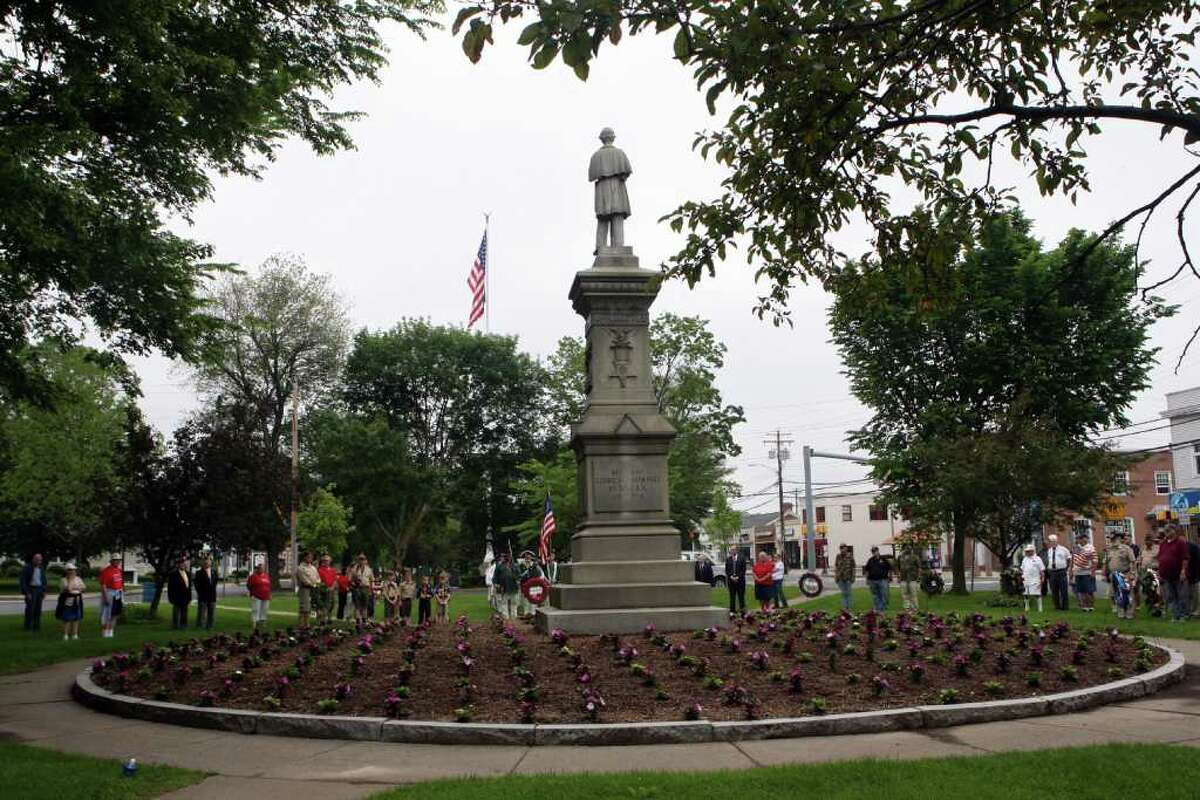 Veterans and community members take part in the Milford wreath laying ceremony on Sunday, May 29, 2011.V