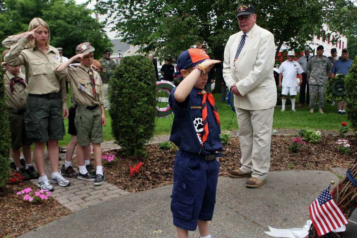 Troop 712 Scout, Copper King, 7, salutes during the Milford wreath laying ceremony on Sunday, May 29, 2011.