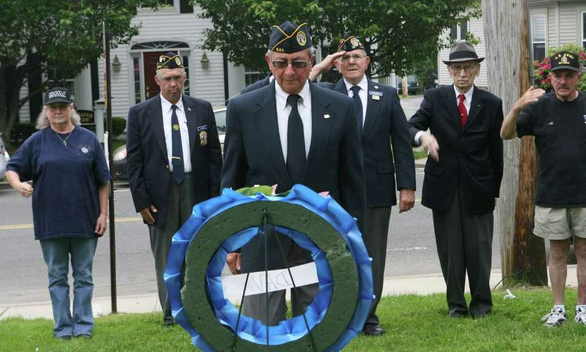 Michael Coplan, of DAV Chapter 15, presents a wreath during the Milford wreath laying ceremony on Sunday, May 29, 2011.