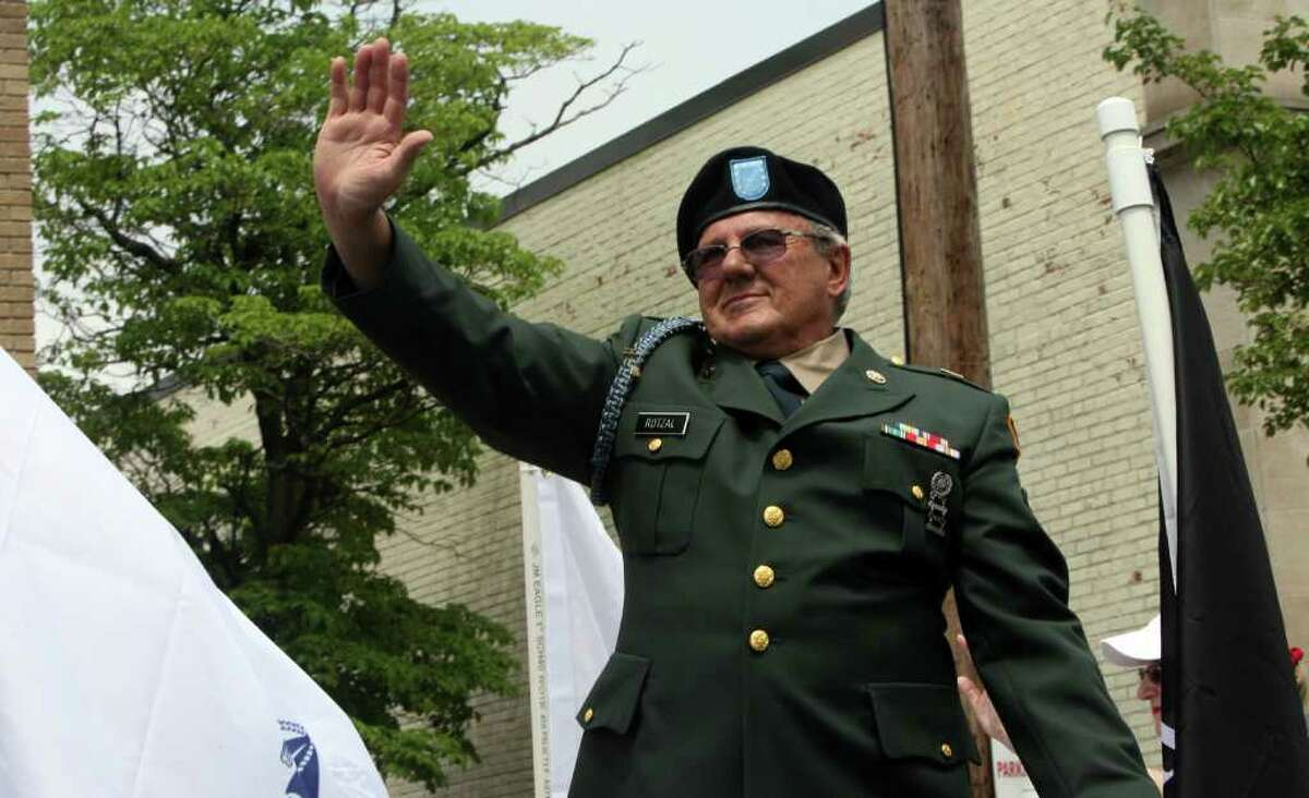 Hank Rotzal, of VFW Post 12084, waves in the Seymour Memorial Day parade on Sunday, May 29, 2011.