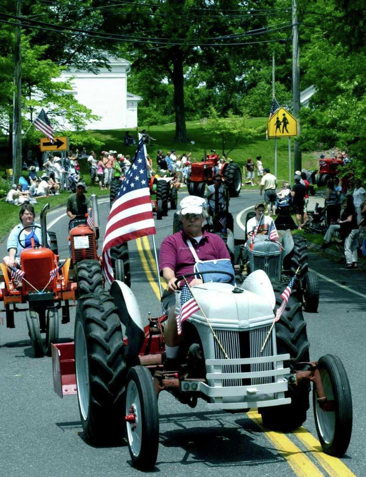 SPECTRUM/Bob Wilbur of New Milford and the Connecticut Antique Machinery Association of Kent guides his 1947 Ford tractor in Sunday's Sherman Memorial Day parade to help the town celebrate its farming heritage. May 29, 2011