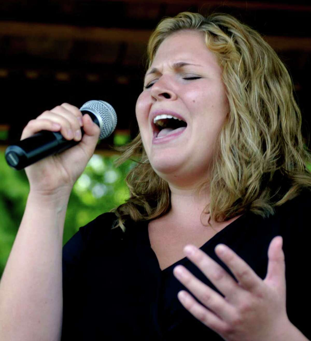 SPECTRUM/Nicole Thorp of Sherman delivers a powerful rendition of the Star Spangled banner Sunday to offer a high point to her town's Memorial Day ceremony. May 29, 2011
