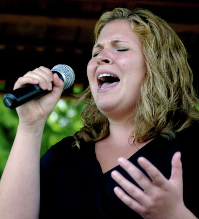 SPECTRUM/Nicole Thorp of Sherman delivers a powerful rendition of the Star Spangled banner Sunday to offer a high point to her town's Memorial Day ceremony. May 29, 2011 Photo: Norm Cummings / The News-Times