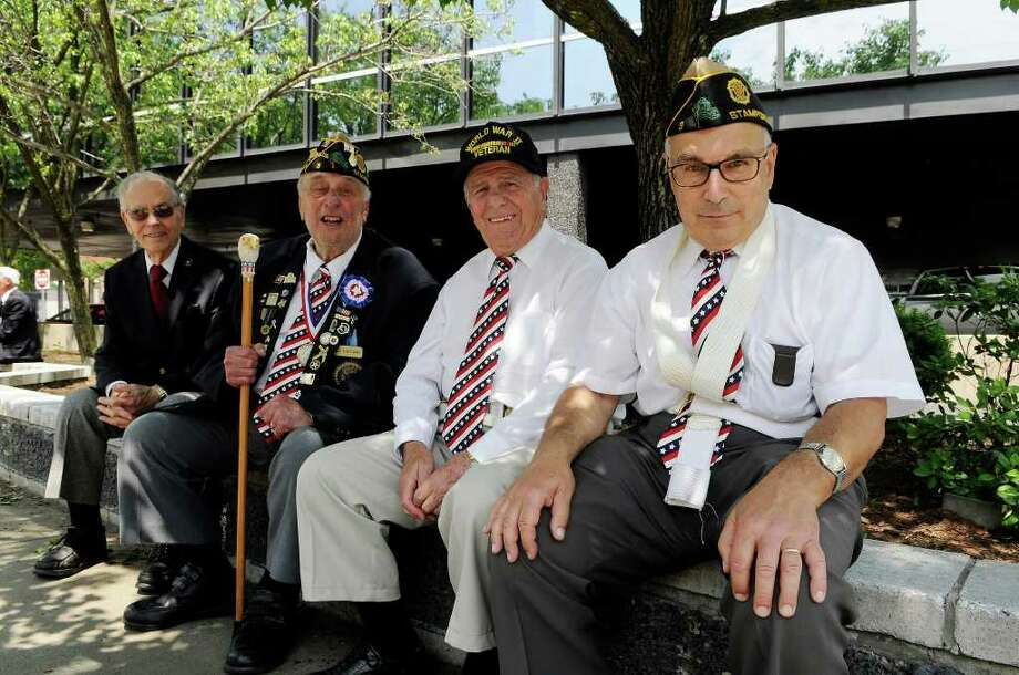 Veterans (L to R) Alfred DiSilvio, Stamford (WWII), Carmine Vaccaro, Stamford (Korea), John LoRusso, Stamford (WWII), and Fred Morabito, Norwalk (Vietnam) prepare to participate in the Memorial Day parade in downtown Stamford, CT on Sunday May 29, 2011. Photo: Shelley Cryan / Shelley Cryan freelance; Stamford Advocate freelance