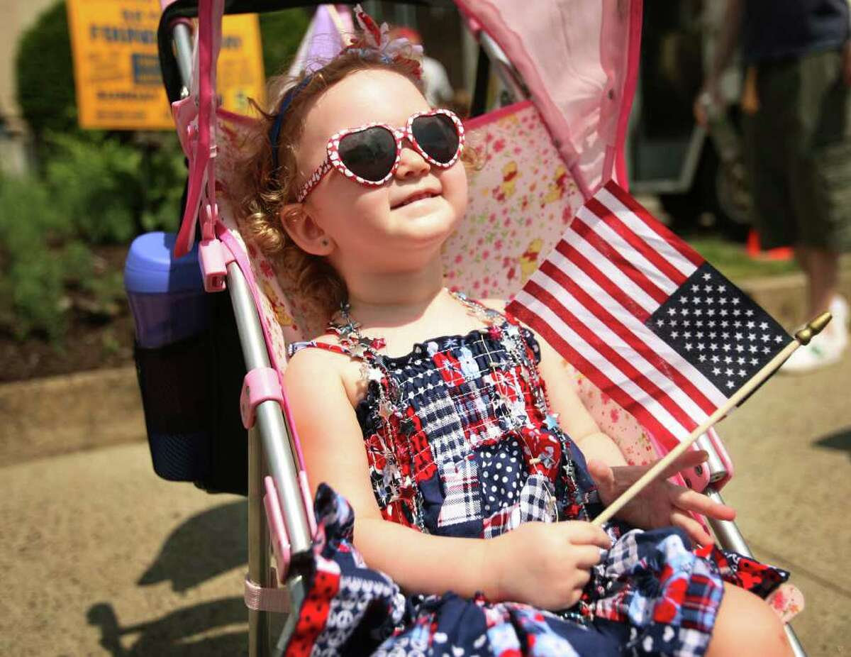 Ava Rising, 20 months of Ansonia, is dressed for the occasion at the annual Memorial Day Parade in downtown Ansonia on Sunday, May 29, 2011.