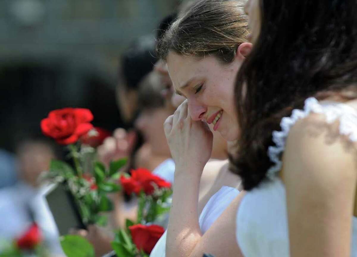 Sirianna Lund Santacrose of Williamstown, Mass. wipes tears from her eyes during the singing of the Alma Mater during the 197th Commencement Exercises at the Emma Willard School, on Sunday morning May 29, 2011 in Troy, NY. ( Philip Kamrass / Times Union)