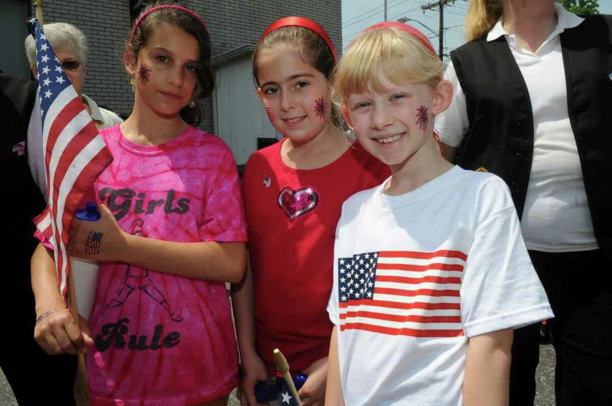 Madison Bloomfeld, 11, left, Jessica Neri, 9, and Kasey Kralik, 9, before the Byram Veterans Association's annual Memorial Day parade on Sunday, May 29, 2011.