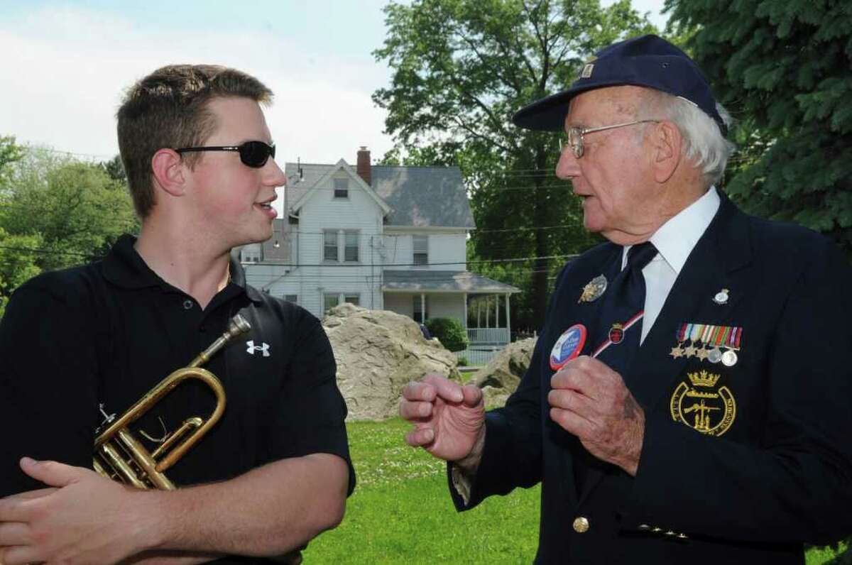 Dan Ingraham speaks with Bill Fullilove, a English Navy veteran 1942-1946, at the Byram Veterans Association's annual Memorial Day parade on Sunday, May 29, 2011.